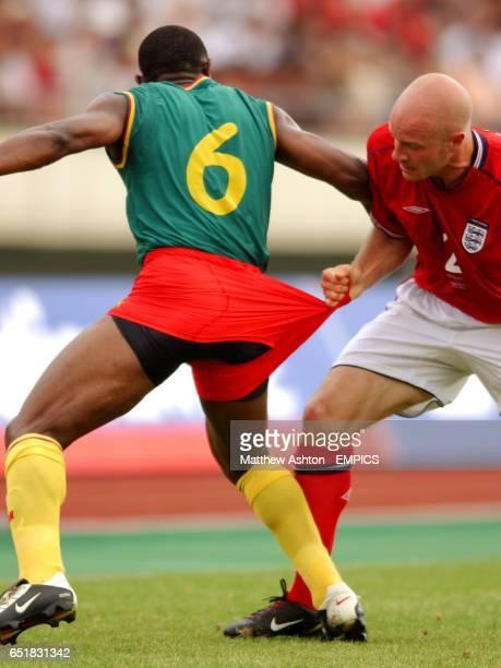 England's Danny Mills pulls the shorts of Cameroon's Pierre Njanka