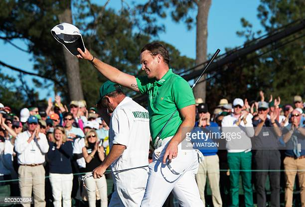 England's Danny Willett celebrates on the 18th green during Round 4 of the 80th Masters Golf Tournament at the Augusta National Golf Club on April 10...