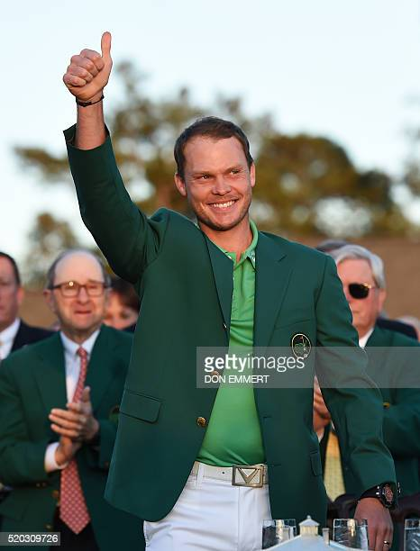 England's Danny Willett gives a thumbs up wearing his Green Jacket at the end of the 80th Masters Golf Tournament at the Augusta National Golf Club...