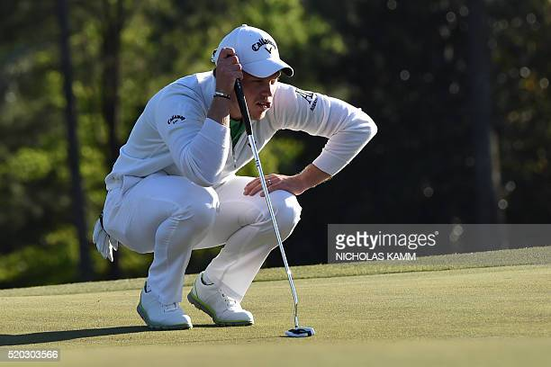 England's Danny Willett lines up his putt on the 18th green during Round 4 of the 80th Masters Golf Tournament at the Augusta National Golf Club on...