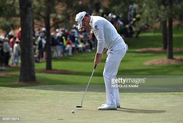 England's Danny Willett putts on the 7th hole during Round 4 of the 80th Masters Golf Tournament at the Augusta National Golf Club on April 10 in...