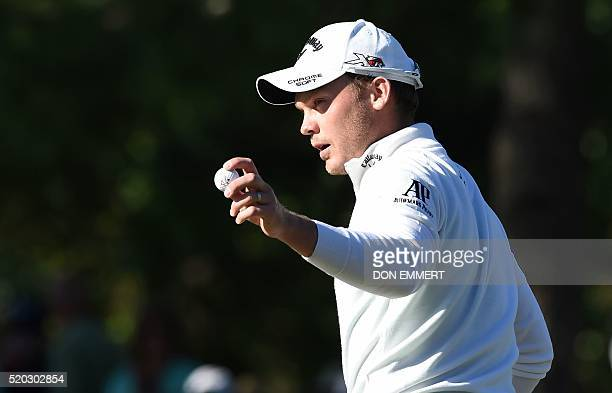 England's Danny Willett reacts after putting on the 14th green during Round 4 of the 80th Masters Golf Tournament at the Augusta National Golf Club...