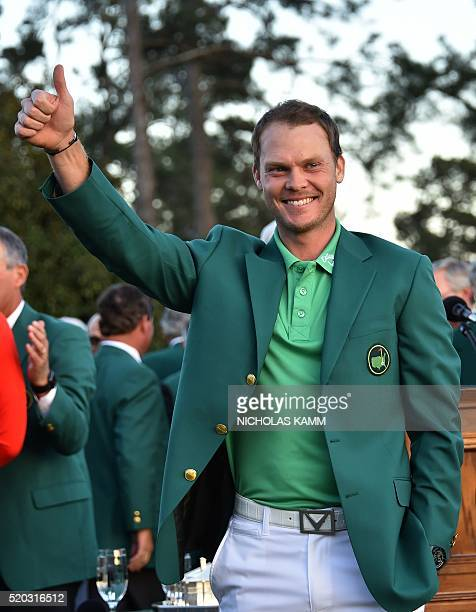 England's Danny Willett smiles wearing the Green Jacket at the end of the 80th Masters Golf Tournament at the Augusta National Golf Club on April 10...
