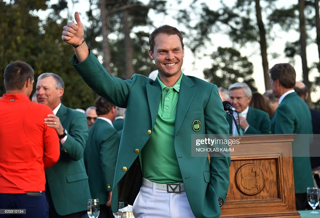 England's Danny Willett waves after receiving his Green Jacket at the end of the 80th Masters Golf Tournament at the Augusta National Golf Club on April 10, 2016, in Augusta, Georgia. England's Danny Willett won the 80th Masters at Augusta National on Sunday for his first major title. He was trailing defending champion Jordan Spieth by five strokes around the turn, but stormed down the back nine to overhaul the American. Willett is the first Englishman since Nick Faldo 20 years ago to win the Masters and only the second all-time. / AFP / Nicholas Kamm
