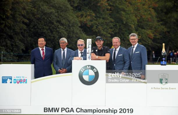 England's Danny Willett with the trophy after winning the BMW PGA Championship at Wentworth Golf Club, Surrey.