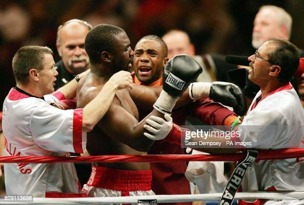 England's Danny Williams celebrates with his corner men after beating Mike Tyson in the fourth round of their heavyweight contest at the Freedom Hall...