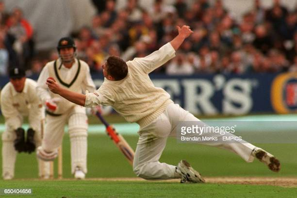 England's Darren Gough dismisses Australia's Mark Taylor caught and bowled