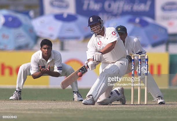 England's Darren Gough hits a boundary off the bowling of Saqlain Mushtaq during his cameo innings of 18 runs on the fourth day of the 3rd Test match...