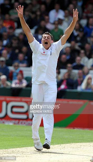 England's Darren Pattinson celebrates after taking the wicket of South Africa's Hashim Amla during the second day of the second test cricket match...