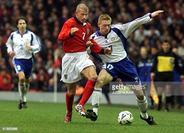 England's David Beckham vies with Finland's Mikael Forssell in a World Cup 2002 qualifier in Liverpool 24 March 2001 Finland's Harri Ylonen looks on