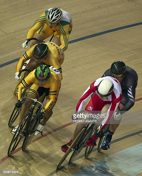 England's David Daniell Malaysia's Azizulhasni Awang Malaysia's Josiah Ng New Zealand's Simon Van Velthooven compete in the men's Keirin cycling...