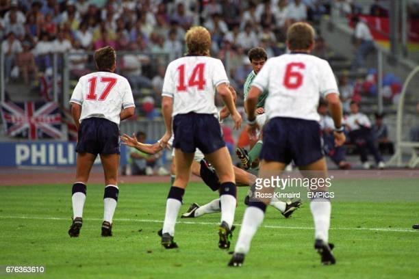 England's David Platt Mark Wright and Terry Butcher line up to block a shot