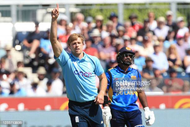 England's David Willey celebrates taking the wicket of Sri Lanka's Charith Asalanka for a duck during the first one-day international between England...