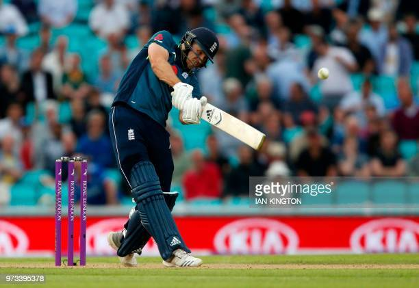 England's David Willey plays a shot for for the winning runs at the end of the first One Day International cricket match between England and...