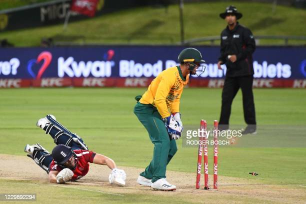 England's Dawid Malan dives to make it ito the crease as South Africa's captain and wicketkeeper Quinton de Kock attempts to stump him out during the...