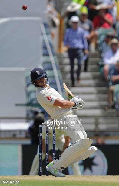 England's Dawid Malan ducks under a bouncer on day two of the third Ashes cricket Test match between England and Australia in Perth on December 15...