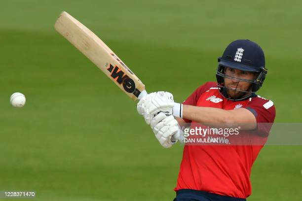 England's Dawid Malan hits a boundary during the international Twenty20 cricket match between England and Australia at the Ageas Bowl in Southampton...
