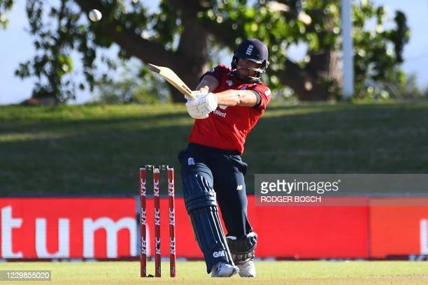 England's Dawid Malan hits a four during the second T20 international cricket match between South Africa and England at Boland Park stadium in Paarl,...