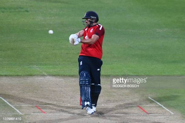 England's Dawid Malan hits a four during the third T20 international cricket match between South Africa and England at Newlands stadium in Cape Town,...