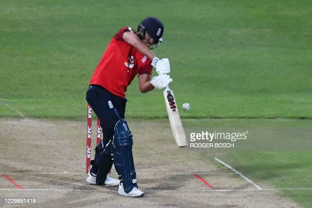 England's Dawid Malan plays a shot during the third T20 international cricket match between South Africa and England at Newlands stadium in Cape...