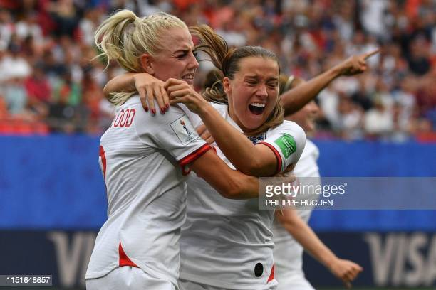 TOPSHOT England's defender Alex Greenwood is congratulated by teammates after scoring a goal during the France 2019 Women's World Cup round of...