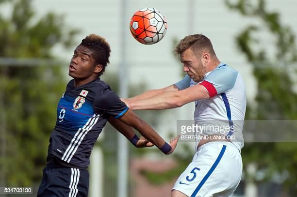England's defender and captain Calum Chambers vies with Japan's forward Ado Onaiwu during the 'Festival International Espoirs' Under 21 football...