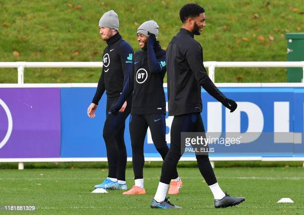 England's defender Ben Chilwell England's midfielder Raheem Sterling and England's defender Joe Gomez attend an England team training session at St...