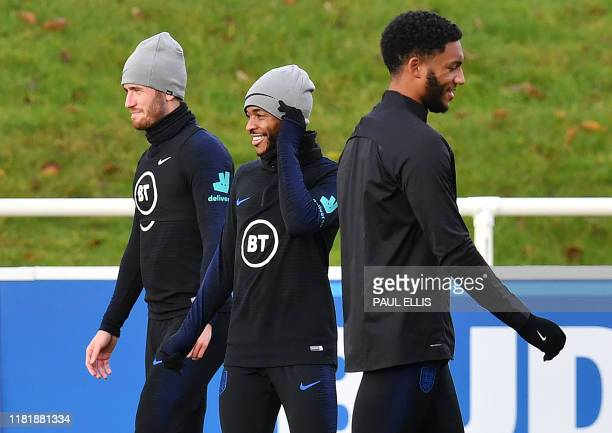 England's defender Ben Chilwell , England's midfielder Raheem Sterling and England's defender Joe Gomez attend an England team training session at St...