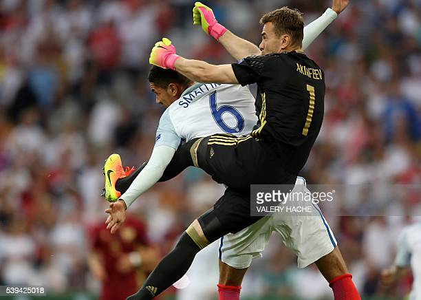 England's defender Chris Smalling vies with Russia's goalkeeper Igor Akinfeev during the Euro 2016 group B football match between England and Russia...