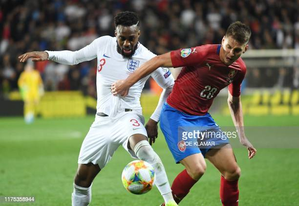 England's defender Danny Rose and Czech Republic's midfielder Lukas Masopust vie for the ball during the UEFA Euro 2020 qualifier Group A football...