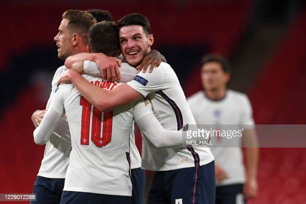 England's defender Declan Rice (2R0 congratulates goalscorer England's midfielder Mason Mount during the UEFA Nations League group A2 football match...