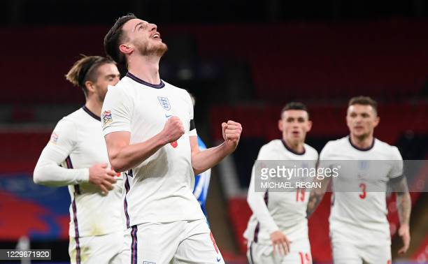 England's defender Declan Rice celebrates scoring the opening goal during the UEFA Nations League group A2 football match between England and Iceland...