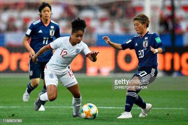 England's defender Demi Stokes vies for the ball with Japan's forward Kumi Yokoyama during the France 2019 Women's World Cup Group D football match...