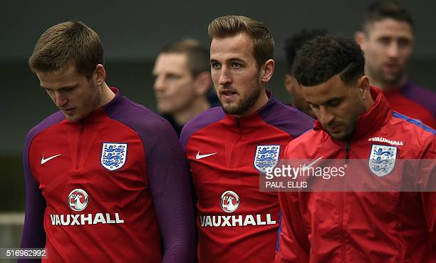 England's defender Eric Dier England's striker Harry Kane and England's defender Kyle Walker take part in a team training session at St George's Park...
