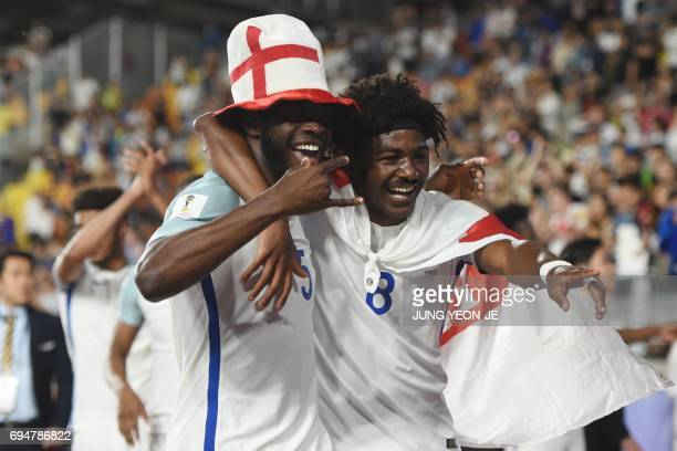 England's defender Fikayo Tomori and England's midfielder Ainsley MaitlandNiles celebrate winning the U20 World Cup final football match between...