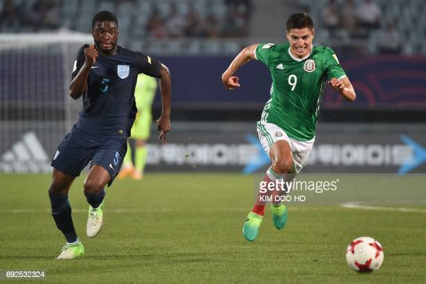 England's defender Fikayo Tomori and Mexico's forward Ronaldo Cisneros compete for the ball during the U20 World Cup quarterfinal football match...