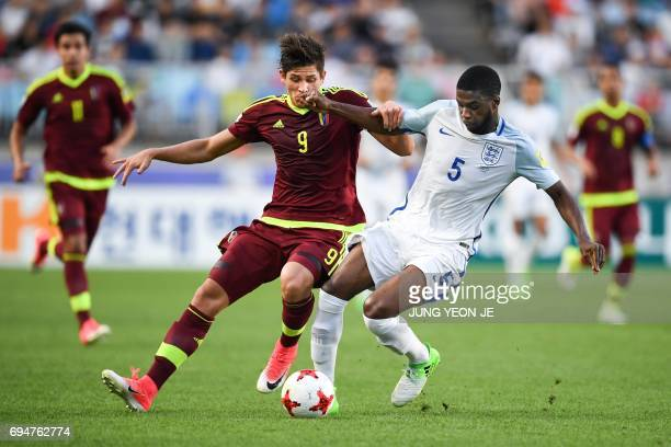 England's defender Fikayo Tomori and Venezuela's forward Ronaldo Pena compete for the ball during the U20 World Cup final football match between...