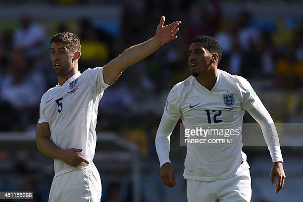 England's defender Gary Cahill gestures alongside England's defender Chris Smalling during the Group D football match between Costa Rica and England...