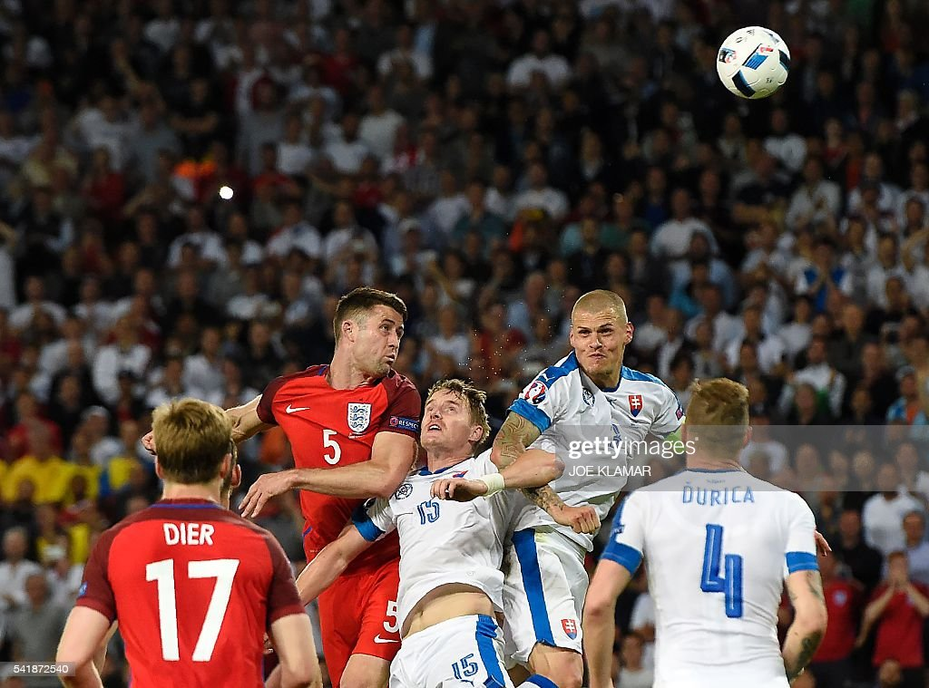 TOPSHOT - England's defender Gary Cahill (C-L) vies for the header with Slovakia's defender Tomas Hubocan (C) and Slovakia's defender Martin Skrtel (C-R) during the Euro 2016 group B football match between Slovakia and England at the Geoffroy-Guichard stadium in Saint-Etienne on June 20, 2016. / AFP / Joe KLAMAR