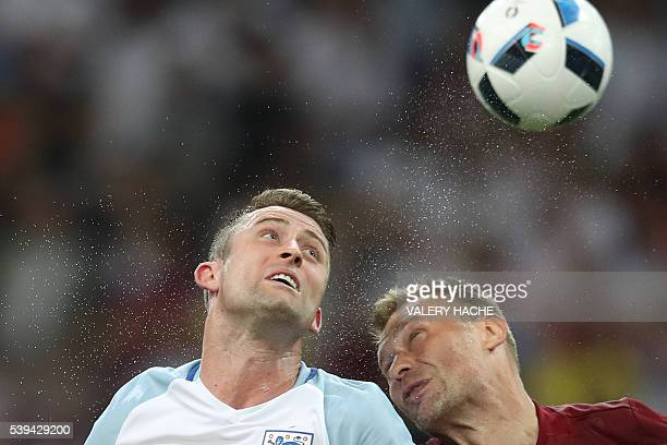 England's defender Gary Cahill vies with Russia's defender Vasily Berezutskiy during the Euro 2016 group B football match between England and Russia...