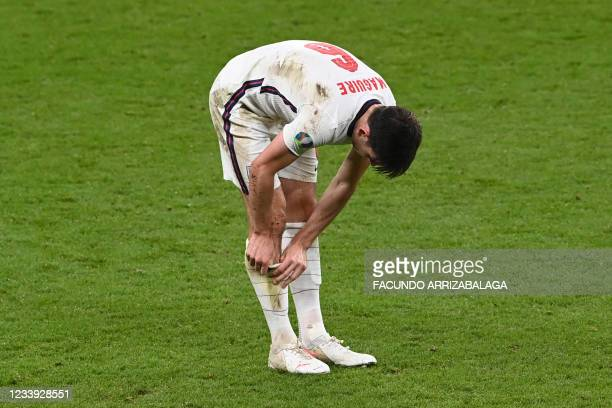 England's defender Harry Maguire adjusts his shin pads during the UEFA EURO 2020 final football match between Italy and England at the Wembley...