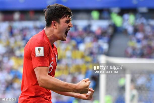 TOPSHOT England's defender Harry Maguire celebrates after scoring the opener during the Russia 2018 World Cup quarterfinal football match between...