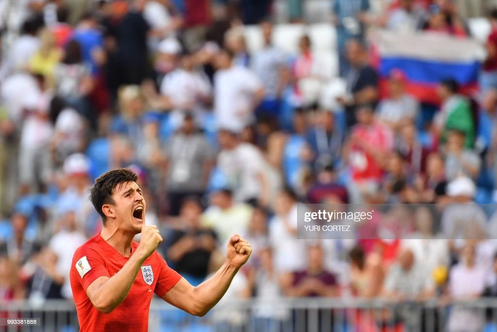 TOPSHOT - England's defender Harry Maguire celebrates at the end of the Russia 2018 World Cup quarter-final football match between Sweden and England at the Samara Arena in Samara on July 7, 2018. (Photo by Yuri CORTEZ / AFP) / RESTRICTED