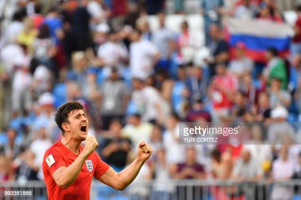 TOPSHOT England's defender Harry Maguire celebrates at the end of the Russia 2018 World Cup quarterfinal football match between Sweden and England at...