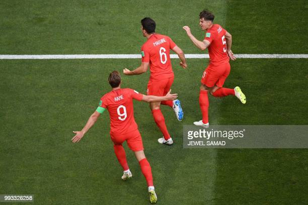 England's defender Harry Maguire celebrates his goal with England's defender John Stones and England's forward Harry Kane during the Russia 2018...
