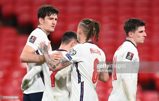 England's defender Harry Maguire celebrates scoring their second goal during the FIFA World Cup Qatar 2022 Group I qualification football match...