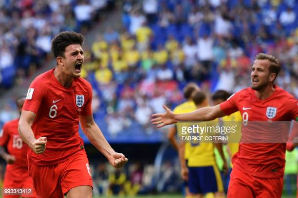 TOPSHOT England's defender Harry Maguire celebrates with England's forward Harry Kane after scoring the opener during the Russia 2018 World Cup...