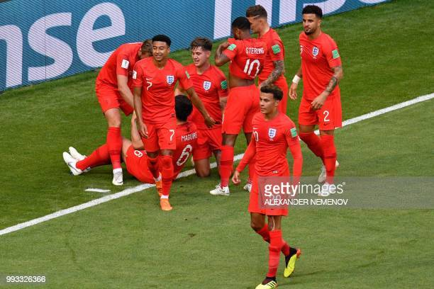 England's defender Harry Maguire celebrates with teammates after scoring the opening goal during the Russia 2018 World Cup quarterfinal football...