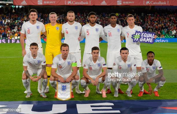 England's defender Harry Maguire England's goalkeeper Jordan Pickford England's defender Joe Gomez England's midfielder Dele Alli and England's...