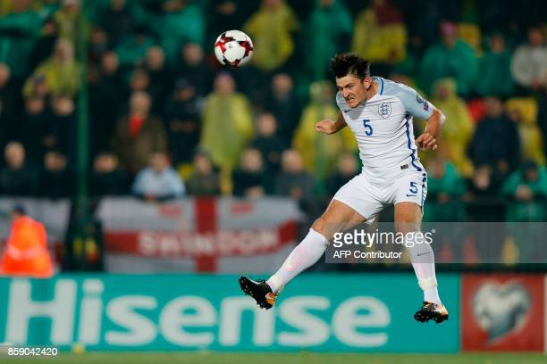 England's defender Harry Maguire heads the ball during the 2018 FIFA World Cup European Qualifying football match between Lithuania and England at...